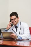 Young Doctor On The Phone Royalty Free Stock Photo