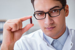 The young doctor with the pill. Young doctor with the pill Royalty Free Stock Photography