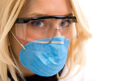 Young doctor portrait. Doctor portrait with mask and glasses Stock Images