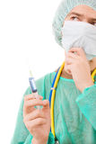 Young doctor portrait with a syringe Royalty Free Stock Photos
