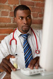 Young doctor prescribing medication. Young doctor or pharmacist prescribing medication Royalty Free Stock Image