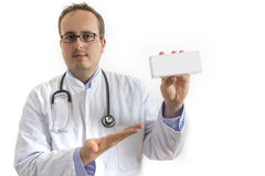 Young Doctor presenting white Box Royalty Free Stock Photo