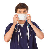 Young doctor putting on mask Royalty Free Stock Image