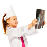 Young doctor radiologist studying an x-ray Royalty Free Stock Photos