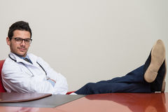 Young Doctor Relaxes Stock Images
