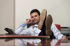 Young Doctor Relaxes Royalty Free Stock Images