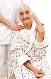 Young doctor's helping hand for the elder ones Stock Photography