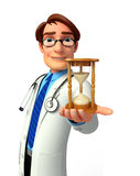 Young Doctor with sand clock Stock Photography