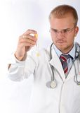 Young doctor see a test-tube Stock Image