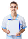 Young doctor showing empty clipboard Stock Images