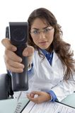 Young doctor showing phone receiver Stock Image