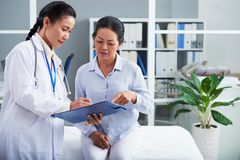 Reading prescription together Royalty Free Stock Image