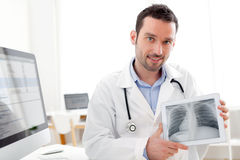 Young doctor showing radiography on a tablet Royalty Free Stock Image
