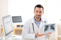 Young doctor showing radiography on a tablet Stock Photography