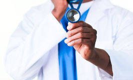 Young doctor showing a stethoscope Stock Photo