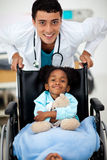 Young Doctor with a sick child. Young Doctor helping a sick child in a hospital Stock Images