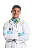 Young doctor smiling. Young doctor with stethoscope and crossed arms smiling royalty free stock images
