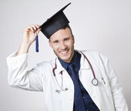 Young doctor smiling with mortarboard Royalty Free Stock Image
