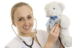 Young doctor with soft toy. Royalty Free Stock Photos