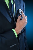 Young doctor standing with his stethoscope Royalty Free Stock Images