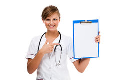 Young doctor standing isolated on white background Royalty Free Stock Photo