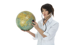 Young doctor with stethoscope and globe Stock Image