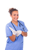 Young doctor with stethoscope with gloves isolated on white back Stock Images