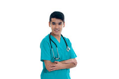 A young doctor with stethoscope looks into the camera and smiling. Isolated on white background Stock Photo