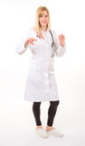 Young doctor with stethoscope standing on white Stock Image