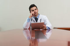 Young Doctor Stressful In The Office Royalty Free Stock Images