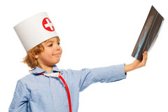 Young doctor studying an x-ray of hand Royalty Free Stock Photography