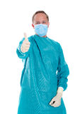 Young doctor with surgical mask and green coat Royalty Free Stock Image