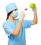 Young doctor with syringe and apple Stock Image