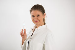 Young doctor with syringe Royalty Free Stock Photos