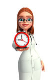 Young Doctor with table clock Royalty Free Stock Image