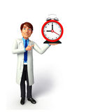 Young Doctor with table clock Stock Photos