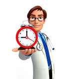 Young Doctor with table clock Stock Image
