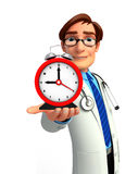 Young Doctor with table clock Royalty Free Stock Photo