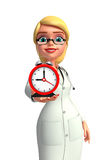 Young Doctor with table clock Royalty Free Stock Images