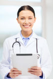 Young doctor with tablet pc and sthethoscope Royalty Free Stock Images