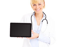 Young doctor with tablet Stock Image