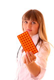 Young doctor with tablets isolated Stock Photo