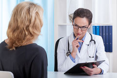 Young doctor talking with a patient Royalty Free Stock Images