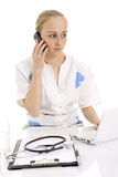 Young doctor talking by phone. Royalty Free Stock Photos