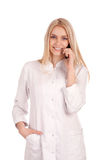 Young doctor talking on phone Royalty Free Stock Photography