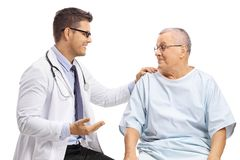 Young doctor talking to an elderly patient stock photo