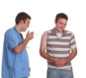 Young doctor about to give his first injection Royalty Free Stock Images