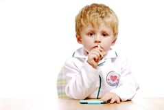 Young doctor toddler. Toddler dressed up as a doctor Stock Photos