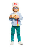 Young doctor in toy glasses with cerebrum dummy. Young 5 years old boy playing a doctor in toy glasses, holding cerebrum dummy, isolated on white royalty free stock photography