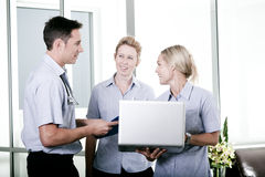 Young doctor with two nurses Royalty Free Stock Photography